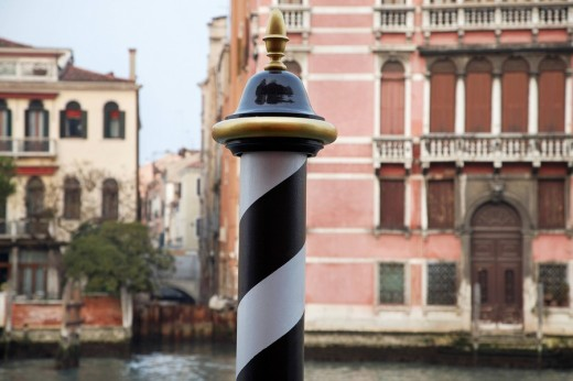 Italy Venice focus on pole by canal : Stock Photo