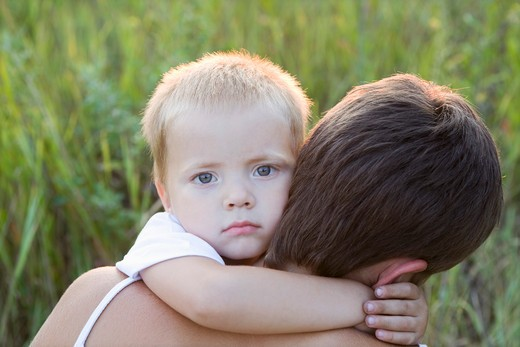 Little Boy Hugging His Mother : Stock Photo