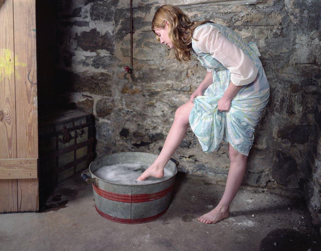 Woman Washing Her Feet : Stock Photo