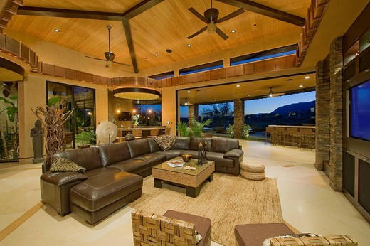 Stock Photo: 1654-49056 Palm Springs, USA. Living room interior with sofa and coffee table in luxury villa