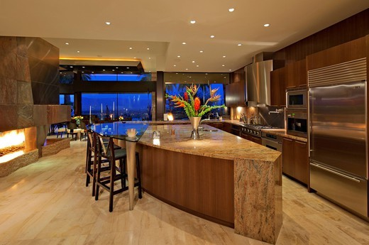 Stock Photo: 1654-49073 Palm Springs, USA. Contemporary kitchen of manor house under lights