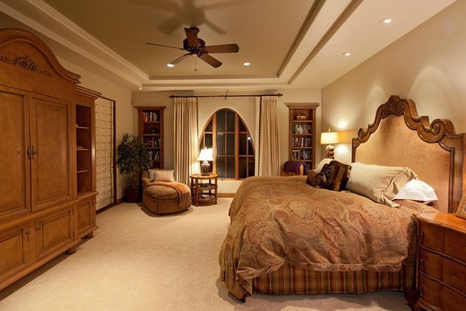 Palm Springs, USA. Comfortable big bed in luxury manor house : Stock Photo