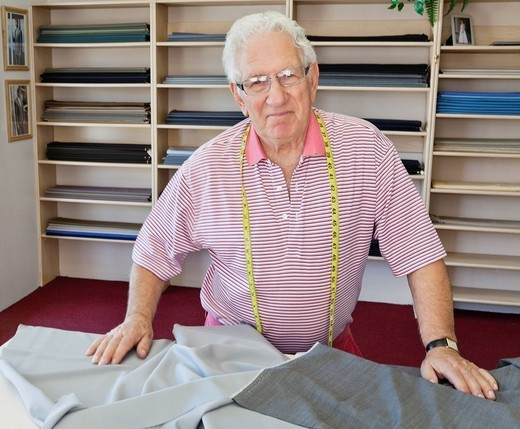 Stock Photo: 1654-50600 Palm Desert, California, USA. Portrait of smiling senior tailor in shop