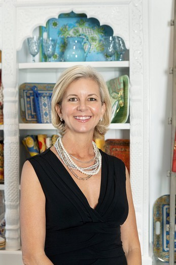 Stock Photo: 1654-53993 Palm Desert, California, USA. Portrait of mature woman smiling while standing in front of shelves
