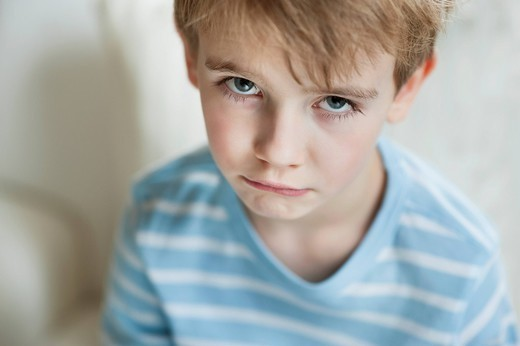Prague, Czech Republic. Portrait of a sad young boy : Stock Photo