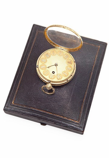 Studio. Old_fashioned pocket watch on top of wallet over white background : Stock Photo