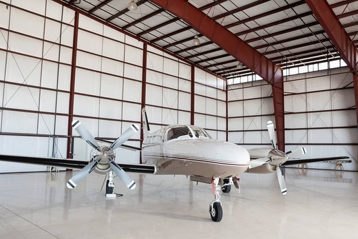 Stock Photo: 1654-56237 Palm Springs, California, USA. Private airplane parked in hangar
