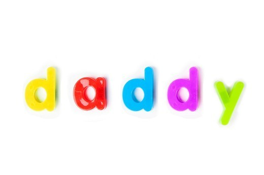 London, UK. Colorful alphabet magnets spell ´daddy´ over white background : Stock Photo