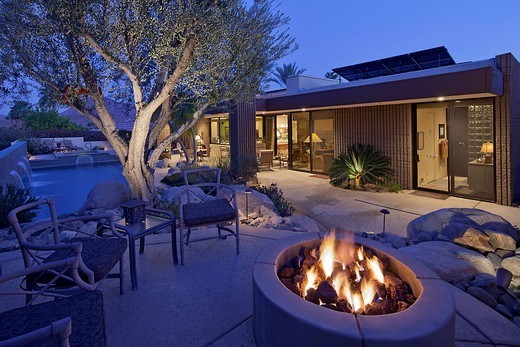 Outdoor fire place by a pool : Stock Photo