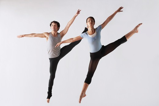Leaping Ballet Dancers in Mid_air : Stock Photo