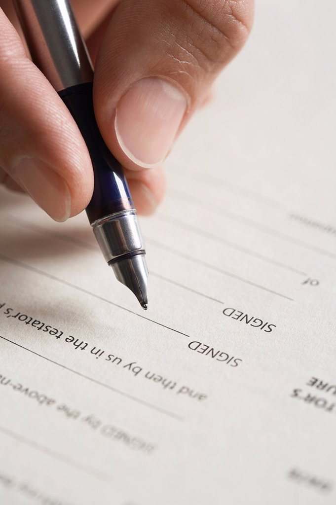 Man signing document close up of pen in hand : Stock Photo