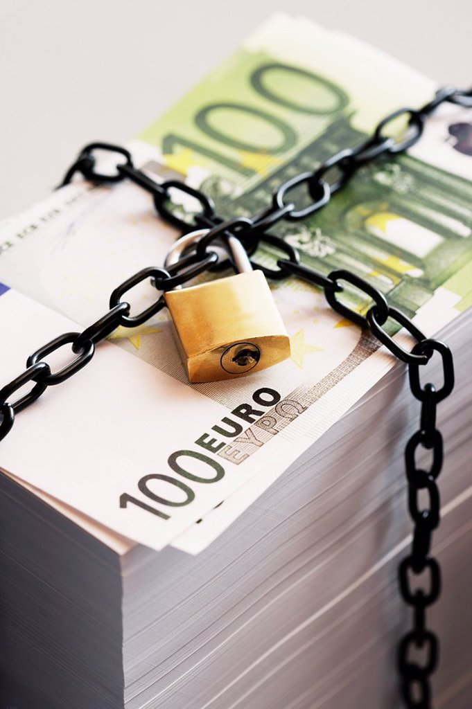 Stock Photo: 1654R-10130 Stack of Euros secured by padlock and chain