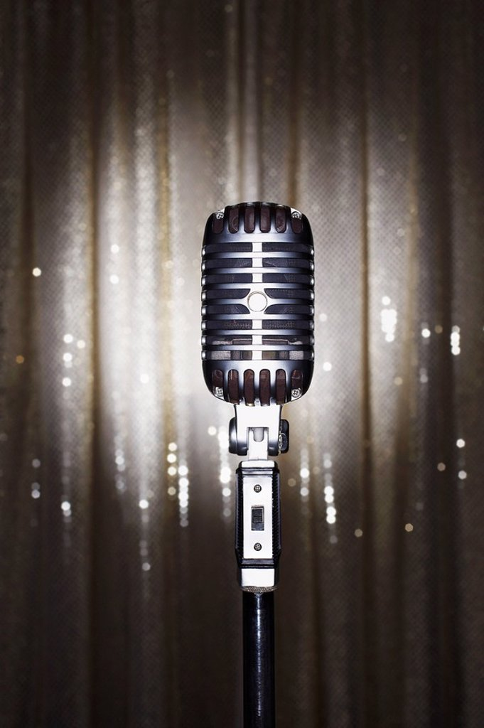 Old fashioned microphone in front of stage curtain : Stock Photo
