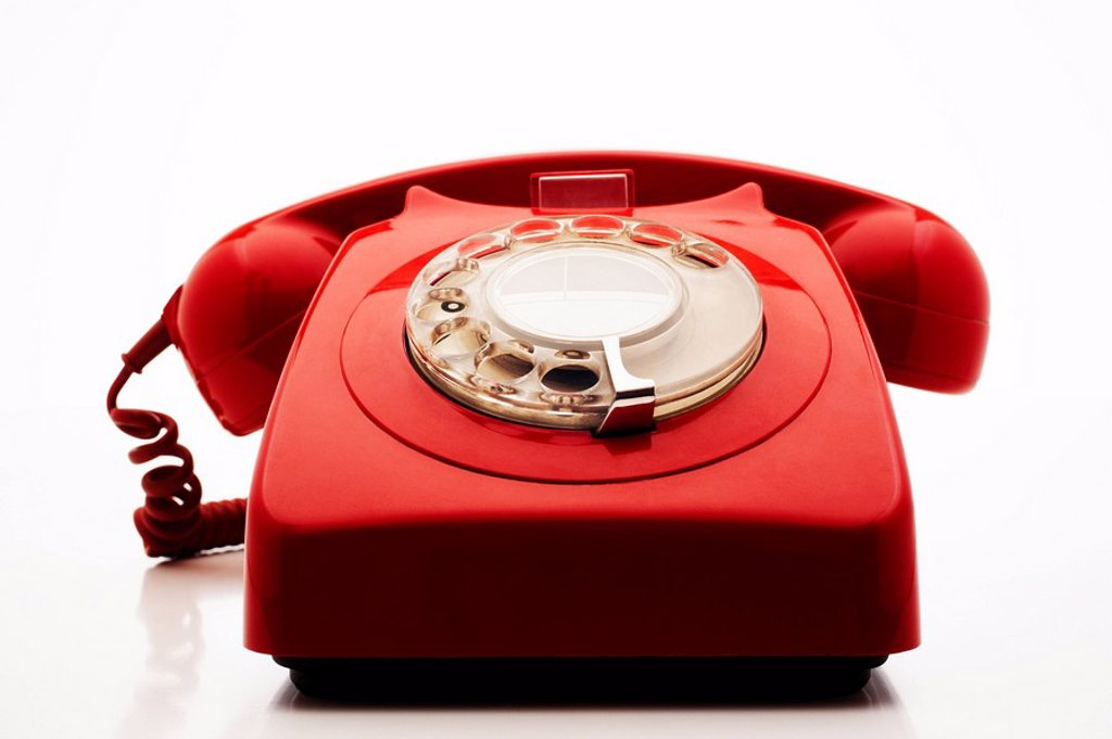 Old fashioned red telephone in studio : Stock Photo