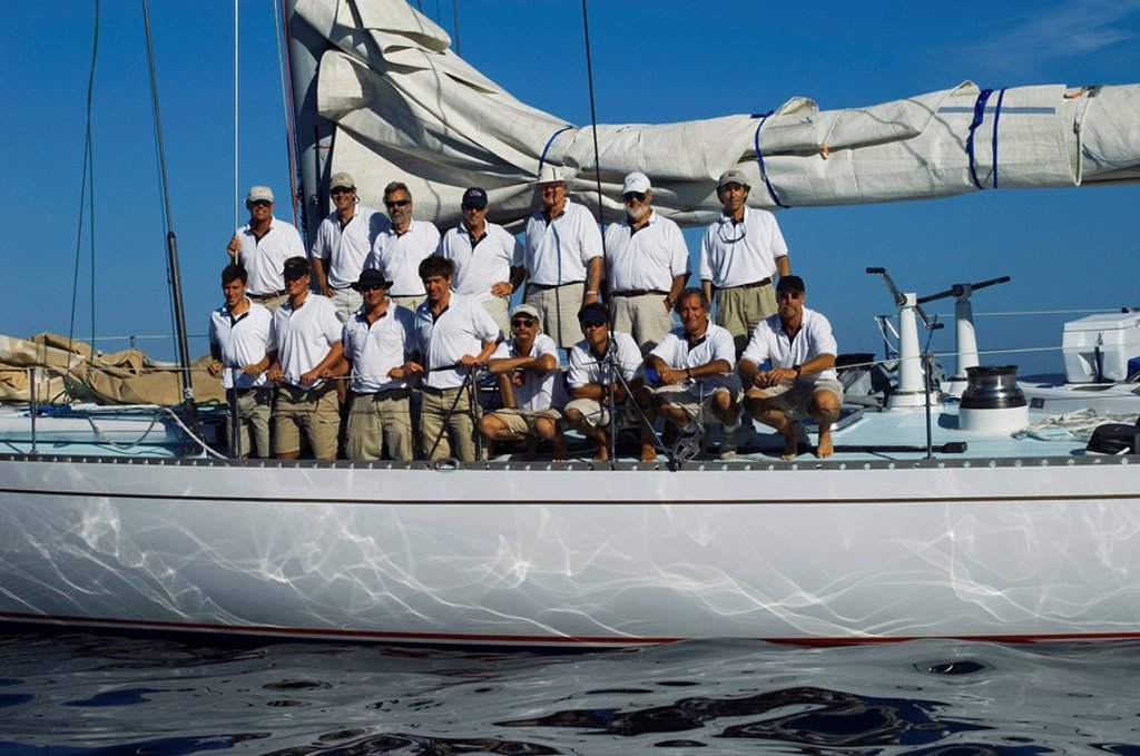 Sailing crew posing for a group portrait on board yacht : Stock Photo