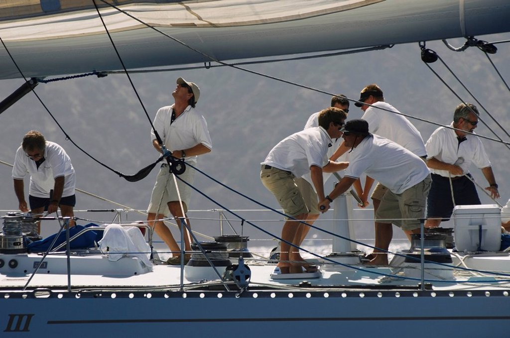 Crew working on yacht side view : Stock Photo