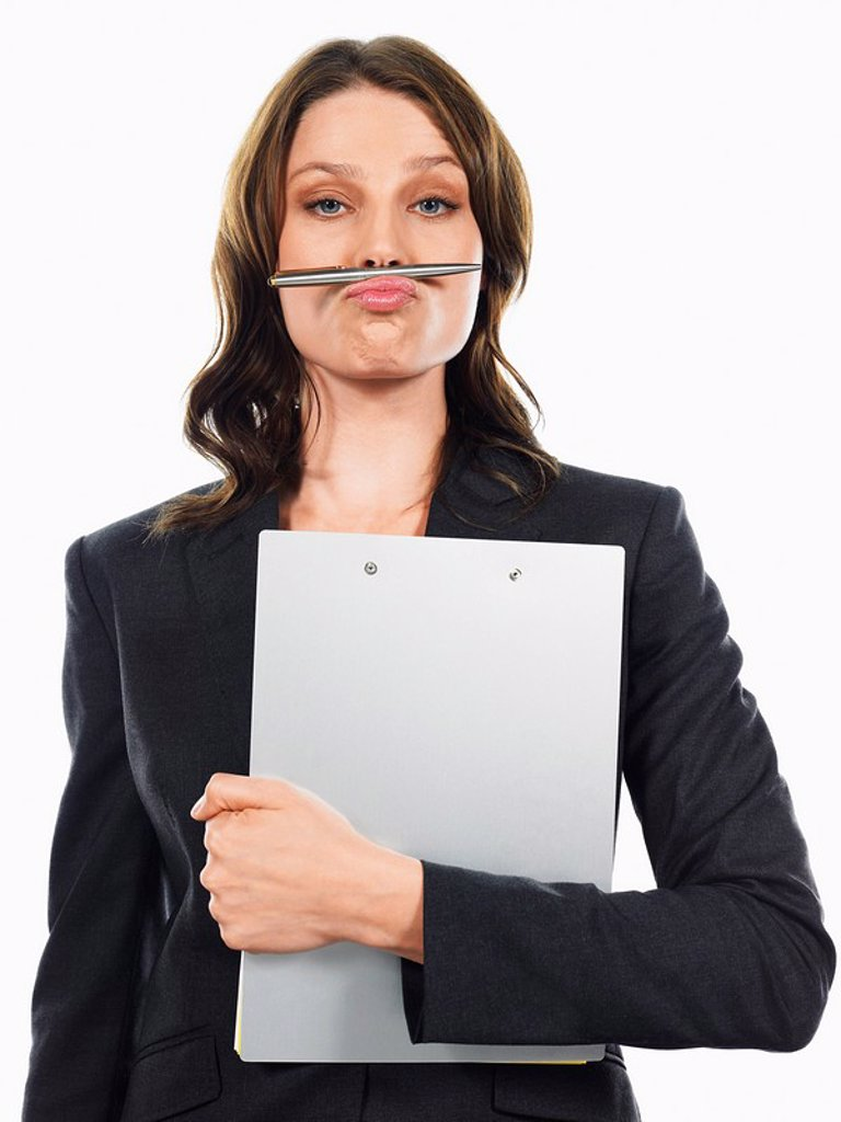 Stock Photo: 1654R-10485 Businesswoman pulling funny face with pen