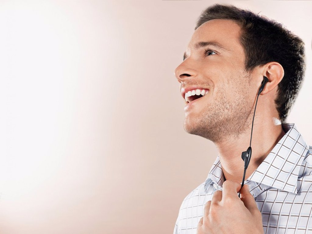 Man with earpiece head and shoulders : Stock Photo