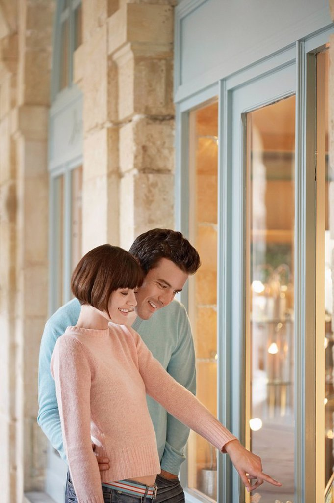 Stock Photo: 1654R-10675 Couple looking in shop window half length