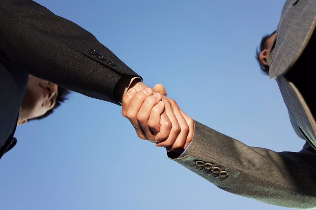 Stock Photo: 1654R-10974 Businessmen Shaking Hands view from below