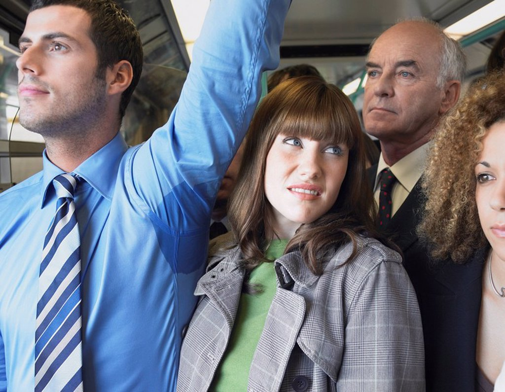 Female Commuter Standing by Man´s Wet Armpit on Train : Stock Photo