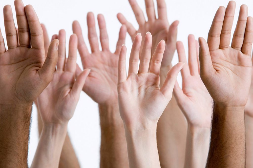 Young men and women raising hands close_up of hands : Stock Photo