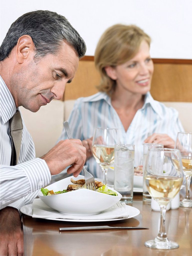 Businesspeople dining in restaurant : Stock Photo