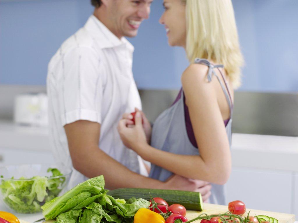 Stock Photo: 1654R-12968 Couple Flirting in Kitchen