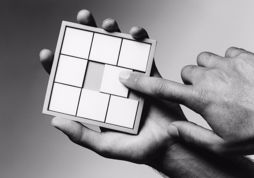 Hands holding slide puzzle b&w close_up : Stock Photo