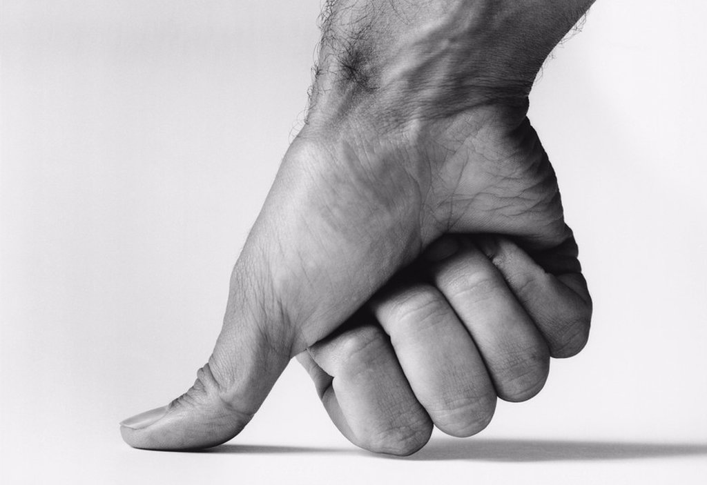 Stock Photo: 1654R-13060 Thumb pressing down b&w close_up