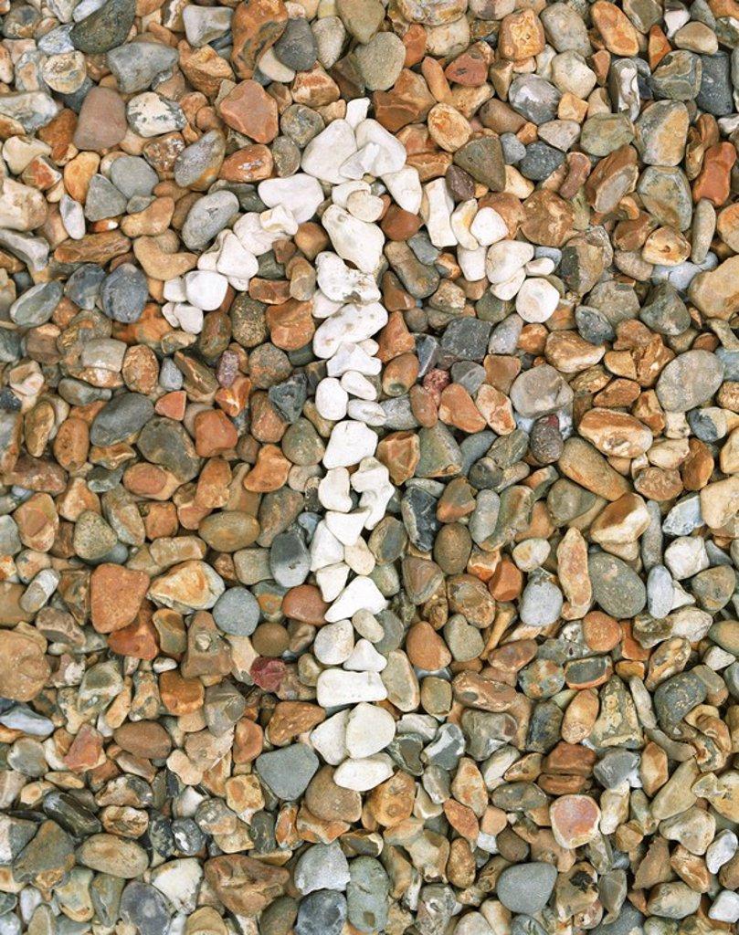 Stock Photo: 1654R-13073 Pebbles stones arrow close_up