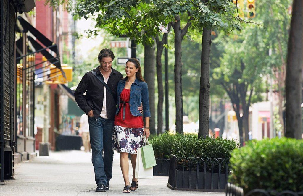 Stock Photo: 1654R-13127 Couple walking on sidewalk