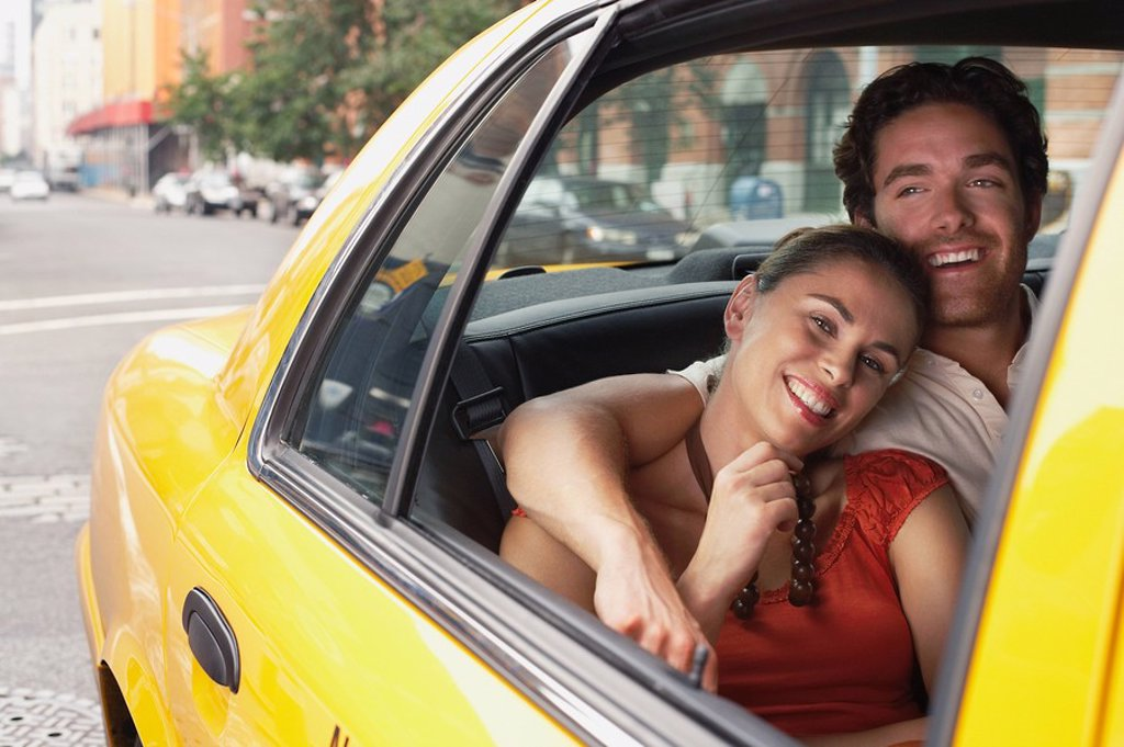Couple in yellow taxi cab : Stock Photo