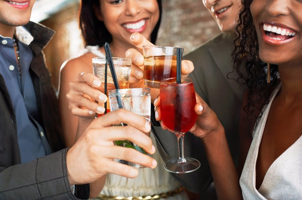 Stock Photo: 1654R-13178 Friends toasting in bar close up on glasses