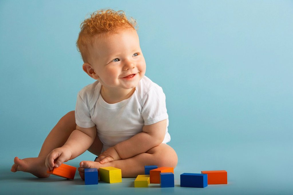Redheaded Baby Playing With Blocks : Stock Photo