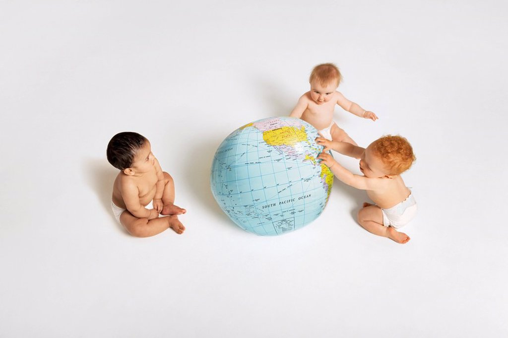 Babies Playing With Globe : Stock Photo