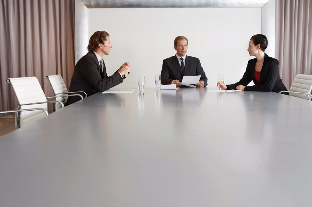 Stock Photo: 1654R-13324 Three Businesspeople Meeting in Conference Room