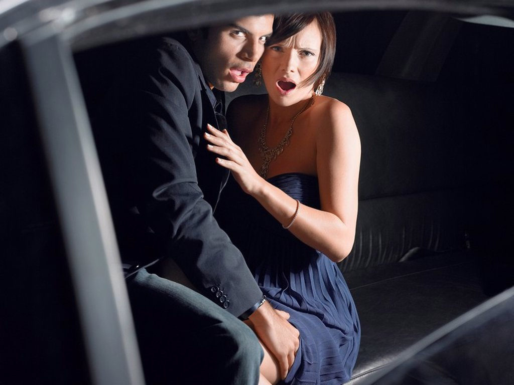 Couple in back of limousine : Stock Photo