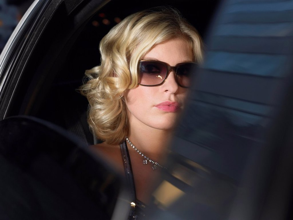 Stock Photo: 1654R-13384 Woman in back of limousine