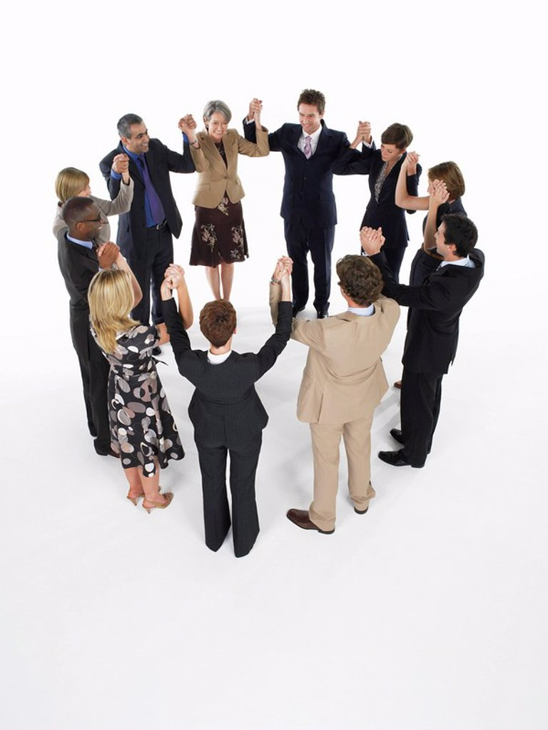 Stock Photo: 1654R-13585 Group of Businesspeople in a circle holding hands