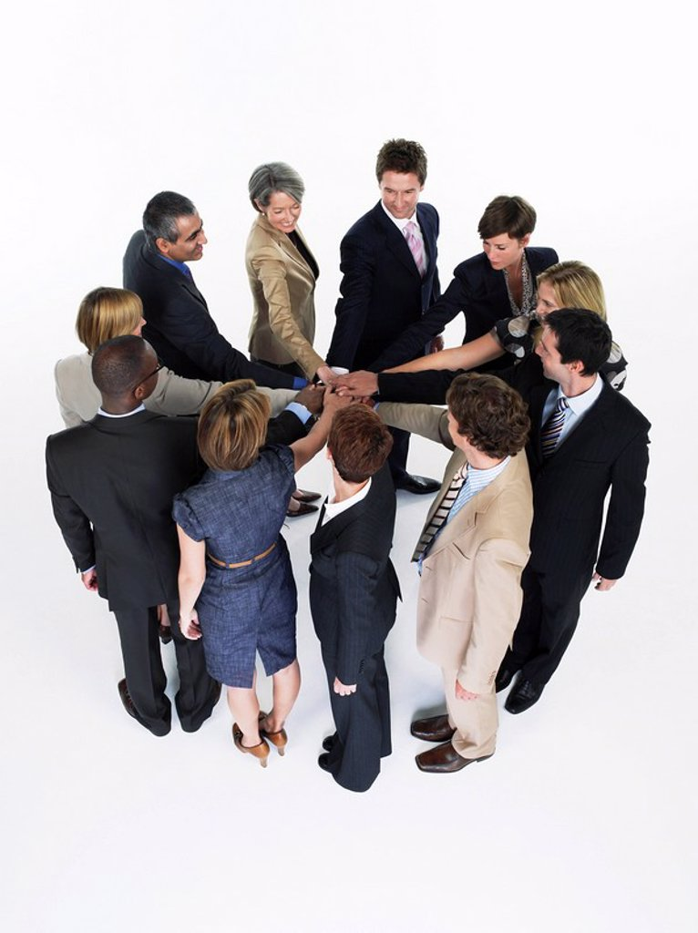 Stock Photo: 1654R-13588 Group of Businesspeople in a circle joining hands