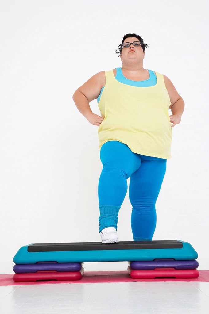 Plus_Size Woman on Exercise Steps : Stock Photo