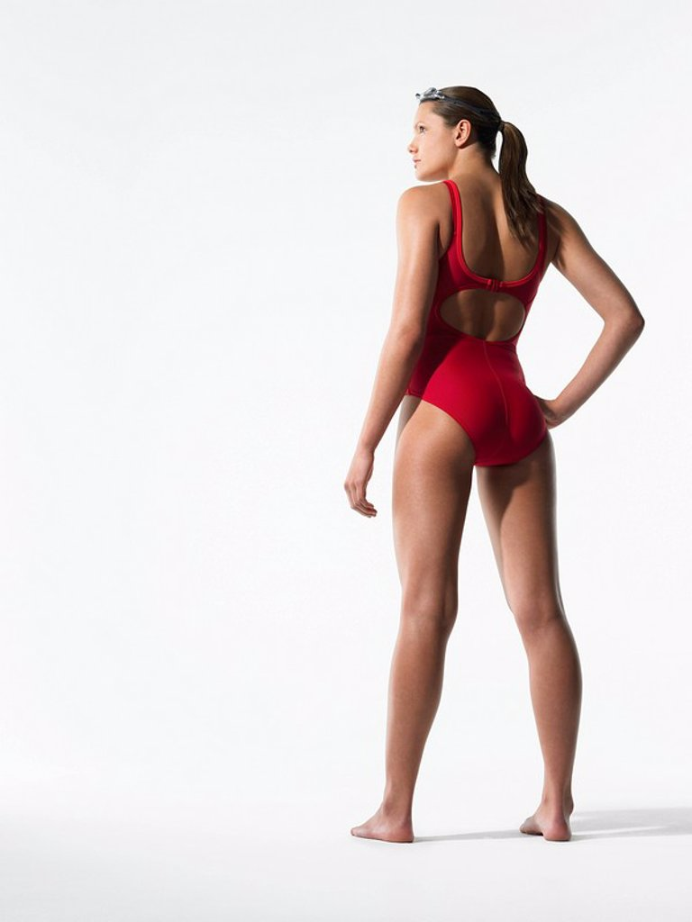 Stock Photo: 1654R-13720 Female swimmer standing back view