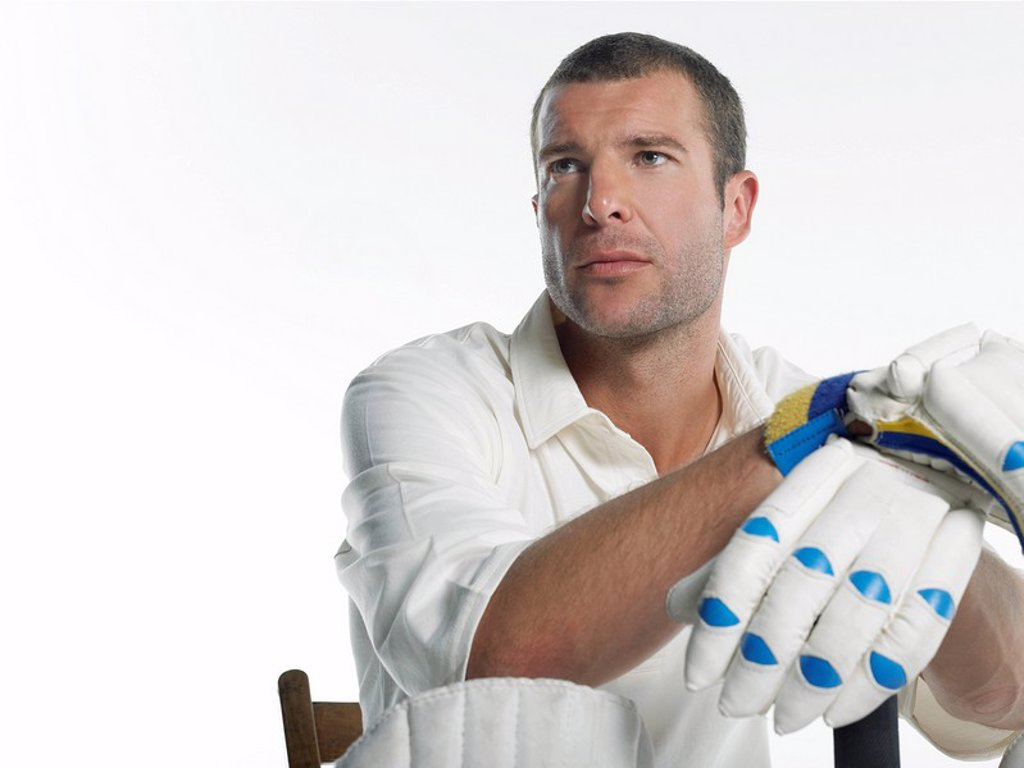Cricket player sitting in chair low angle view : Stock Photo