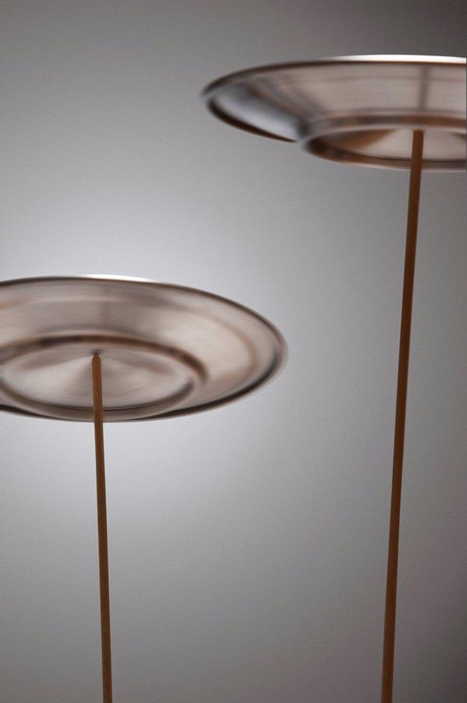 Stock Photo: 1654R-13786 Plates Spinning on Sticks