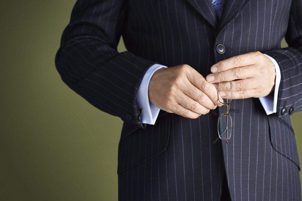 Businessman Holding Glasses : Stock Photo