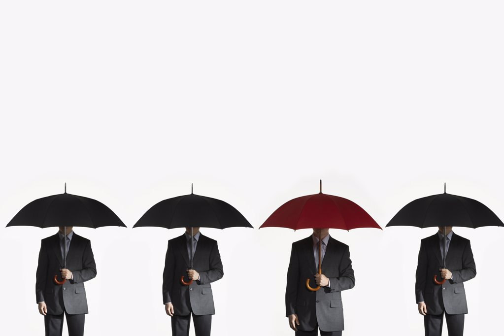Businessmen with Umbrellas : Stock Photo