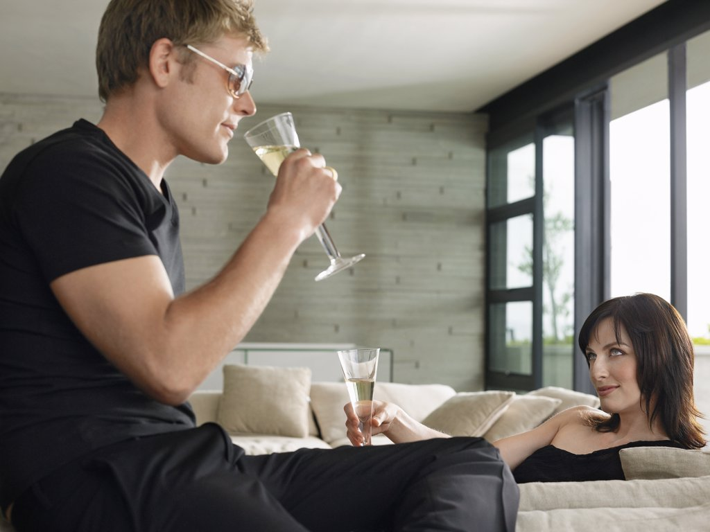 Stock Photo: 1654R-14110 Couple Drinking Champagne
