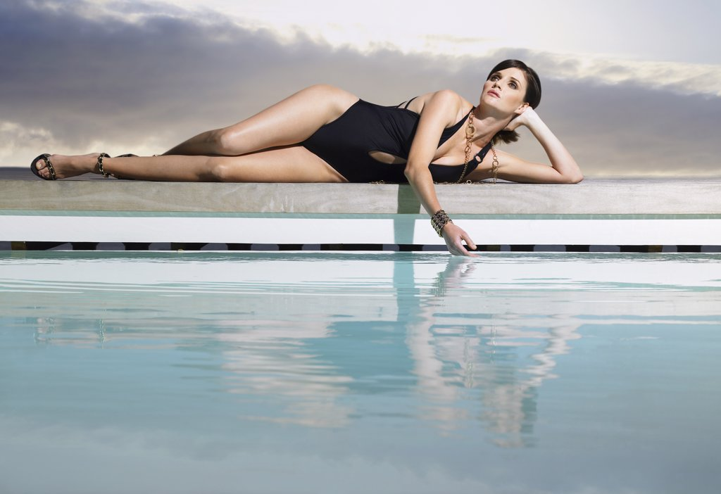 Woman Lying Near a Pool : Stock Photo