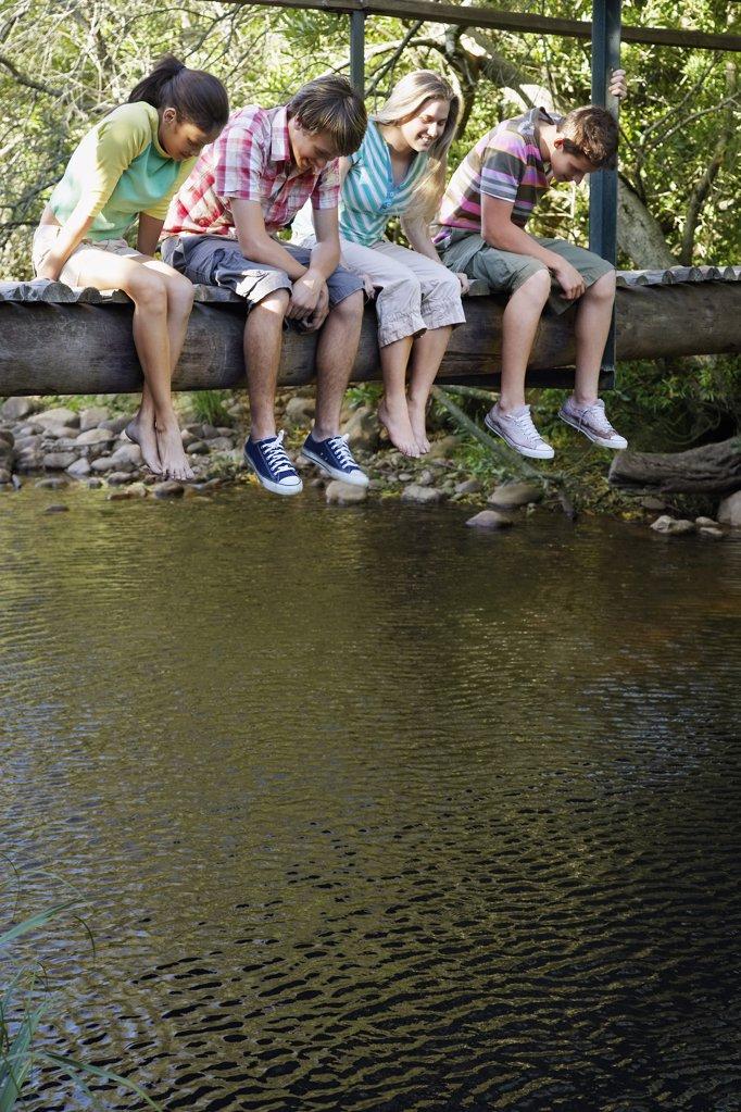 Teens Sitting on Bridge : Stock Photo